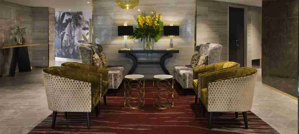 Grand Mercure Wellington lobby chairs flowers
