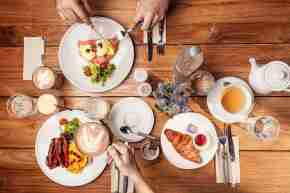 James Cook breakfast food flat lay hands