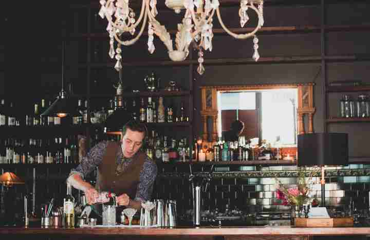 Night Flower bartender pouring drinks chandelier