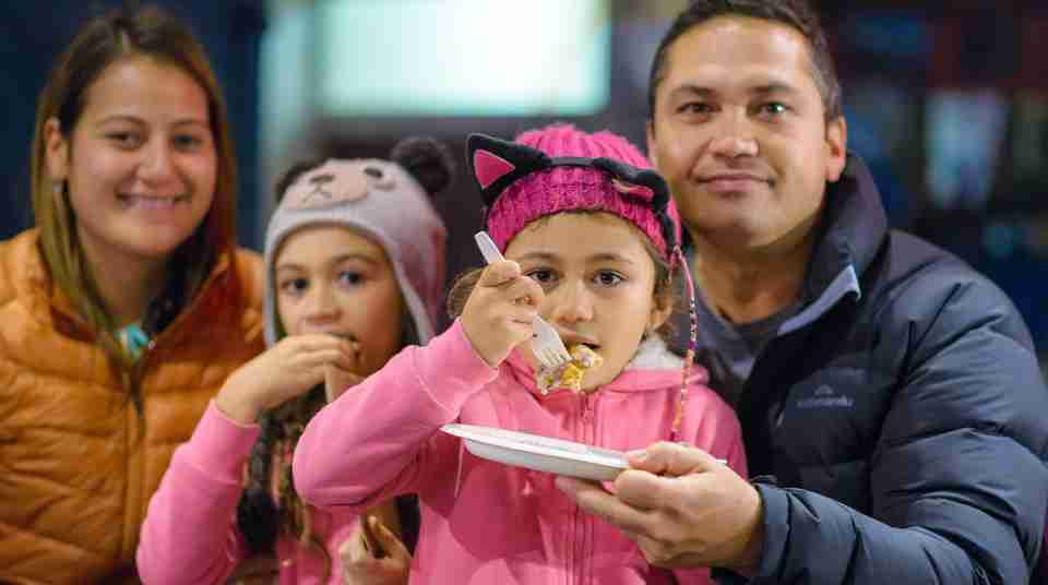 Family eating at Wellington Night Markets