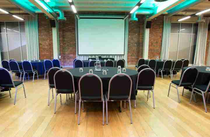 BE Harbourside Function Centre chairs screen wooden floor v2