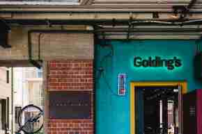 Goldings exterior blue sign day