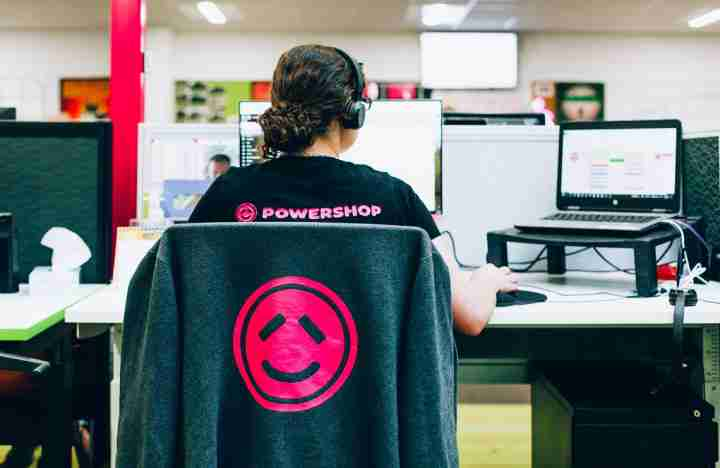 business Powershop credit anna briggs corporate electric utility company working office space desks people person woman lady staff employee logo 1