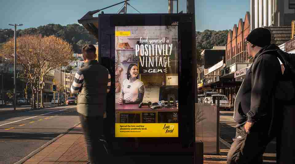 buy local promotional poster on a bus stop