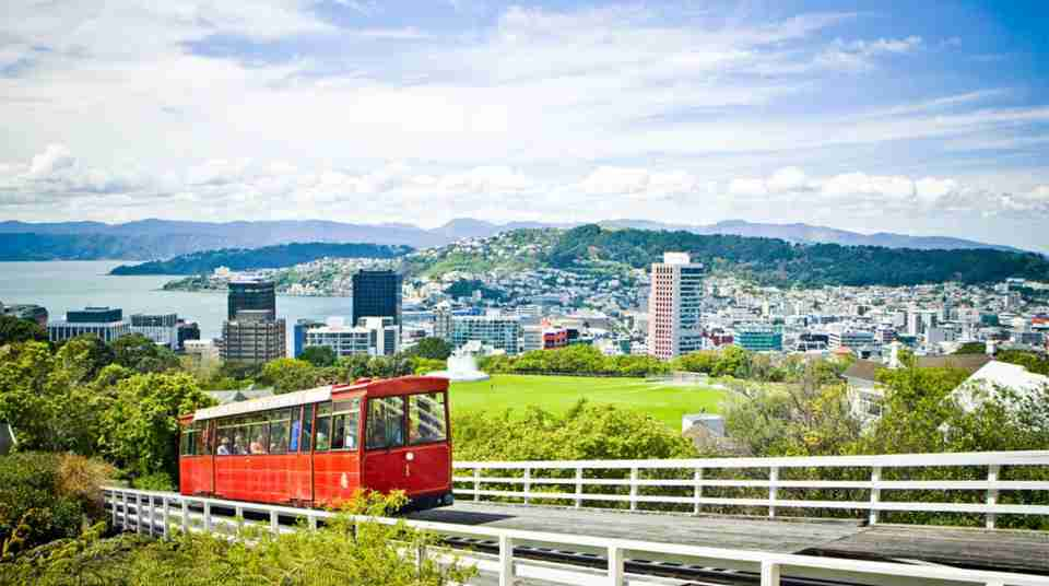 Wellington Cable Car_People on board Wellington City background