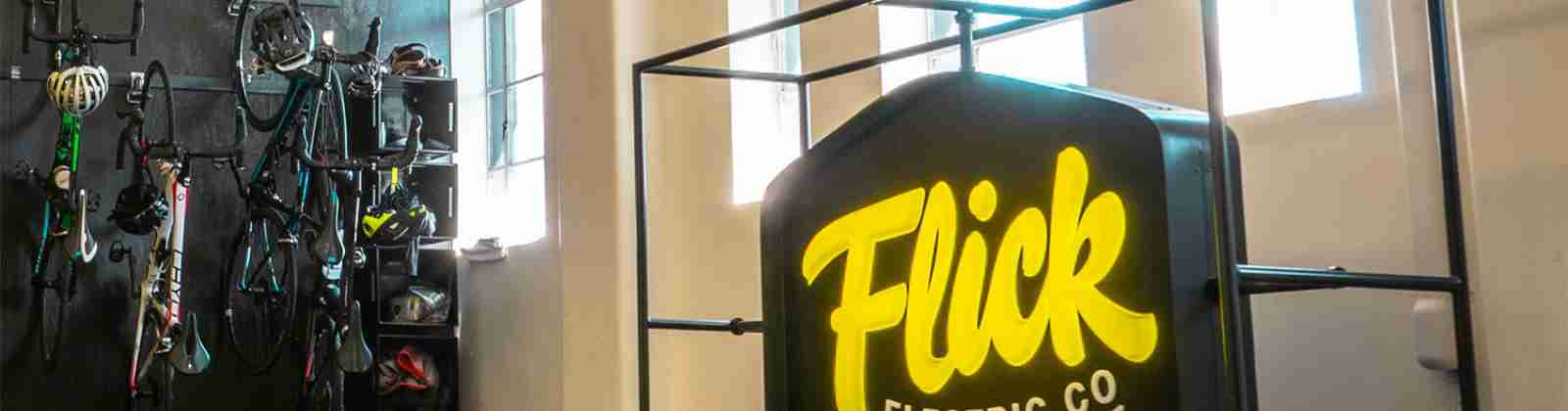 Flick Electric neon sign bike rack